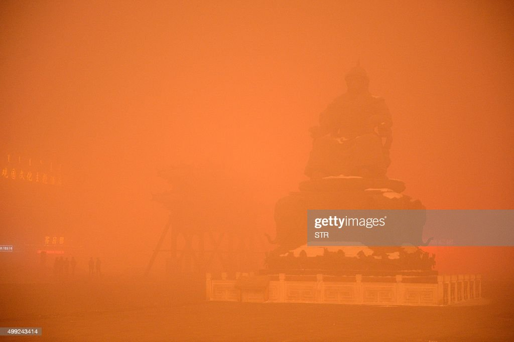 This picture taken on November 29 2015 shows a Genghis Khan statue on a polluted day in Hohhot north China's Inner Mongolia region Northern China...