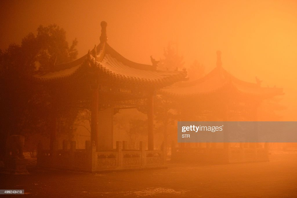 This picture taken on November 29 2015 shows pagodas on a polluted day in Hohhot north China's Inner Mongolia region Northern China choked under some...