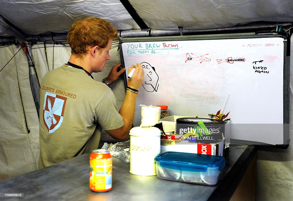 This picture taken on November 3, 2012 shows Britain's Prince Harry drawing the shift brew person (who makes the tea all day) during his 12 hour VHR (very high ready-ness) shift at the British controlled flight-line at Camp Bastion in Afghanistan's Helmand Province, where he was serving as an Apache helicopter pilot/gunner with 662 Sqd Army Air Corps. Britain's Prince Harry confirmed he killed Taliban fighters during his stint as a helicopter gunner in Afghanistan, it can be reported after he completed his tour of duty on January 21, 2013.