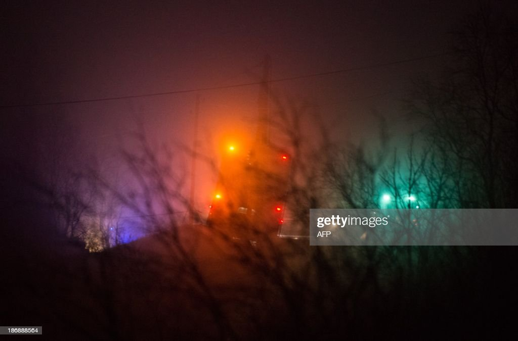 This picture taken on November 4, 2013 shows a hijacked bus in Aardal, western part of Norway. Three people were killed Monday when a man armed with a knife hijacked a bus in western Norway, local police said. AFP Photo /NTB scanpix / Mads Heggo /NORWAY OUT
