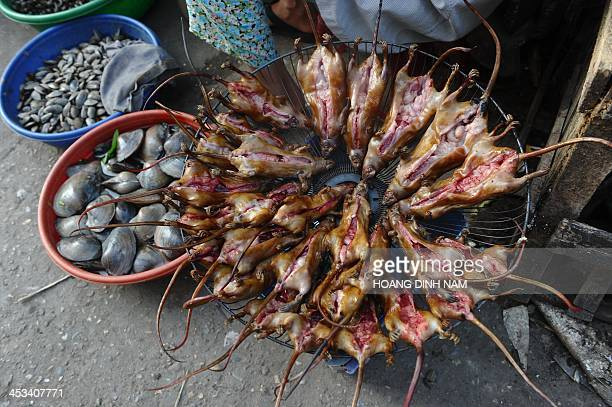 This picture taken on November 4 2013 shows a vendor selling slaughtered rats at a village market in Dan Phuong on the outskirts of Hanoi In somes...