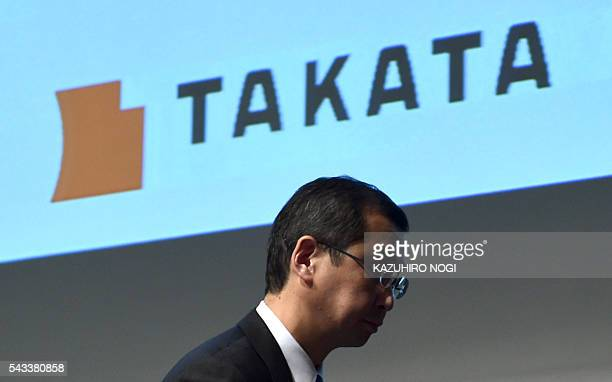 This picture taken on November 4 2015 shows Japan's Takata Corp President Shigehisa Takada leaving a press conference in Tokyo On June 28 2016 Takata...