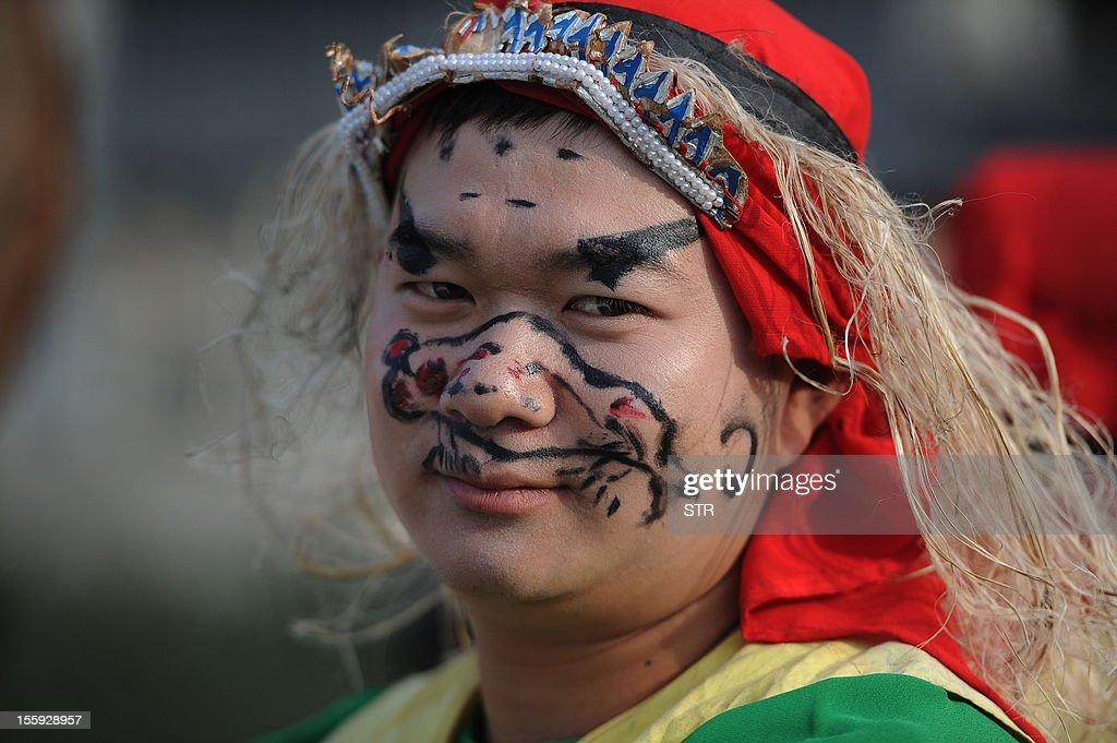 This picture taken on November 7, 2012 shows a man performing in makeup during the opening ceremony of an old town during the first Intangible Cultural Heritage Exhibition of Chinese Traditional Art held in Huangshan, central China's Anhui province. China will set up a system to eliminate poorly-managed intangible cultural heritage, according to a notice issued by the Ministry of Culture on September 6. CHINA OUT AFP PHOTO CHINA OUT AFP PHOTO