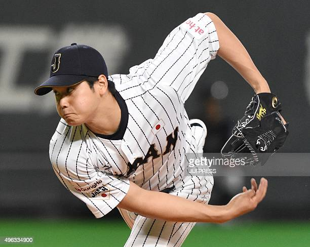This picture taken on November 8 2015 shows Japanese pitcher Shohei Otani of Nippon Ham Fighters hurling the ball during the opening game of the...
