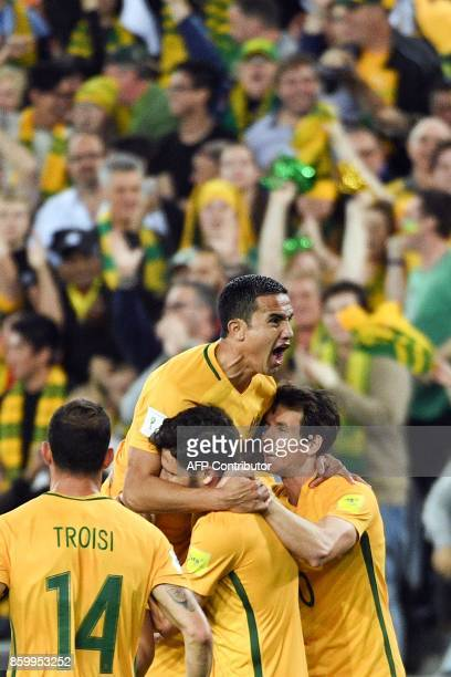 This picture taken on October 10 2017 shows Australia's Tim Cahill celebrating his goal with teammates against Syria during their 2018 World Cup...