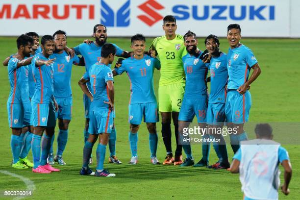 This picture taken on October 11 2017 shows India's captain Sunil Chhetri and his teammates celebrating their team's victory in the 2019 AFCAsian Cup...