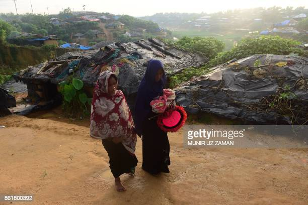TOPSHOT This picture taken on October 12 2017 shows Rohingya woman Hasina Aktar and her mother in law Fatema with the newborn baby Mohammed Jubayed...