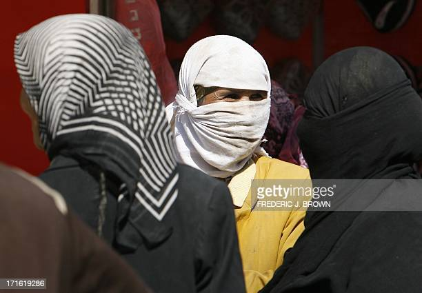 This picture taken on October 13 2006 in Khotan also known as Hotan or Hetian shows Uighur women in their headscarves in this Muslim town in...