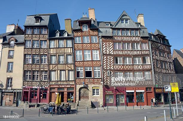 This picture taken on October 13 2013 shows medieval timber framed houses in the centre of Rennes western France AFP PHOTO / DAMIEN MEYER