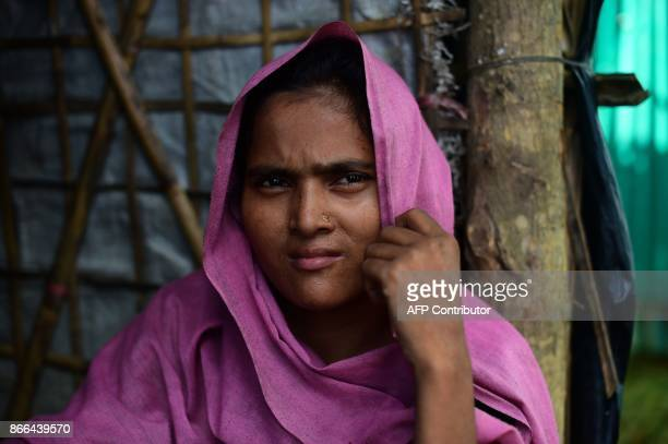 This picture taken on October 13 2017 shows Rohingya refugee Sohura Khatun posing for a photo in Kutupalong refugee camp in Ukhia The lines on their...