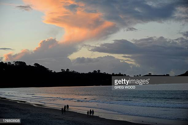 This picture taken on October 14 2011 shows a sunset at Onetangi Beach on Waiheke Island in the Hauraki Gulf near Auckland as the 2011 Rugby World...