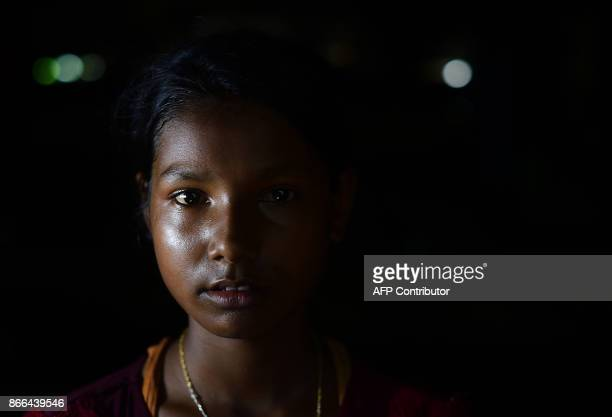 This picture taken on October 14 2017 Rohingya refugee Zohra Begum posing for a photo in Kutupalong refugee camp in Ukhia The lines on their...