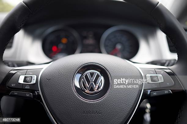 This picture taken on October 15 2015 in Cardiff shows a Volkswagen logo on the steering wheel of a car The German authorities tightened the screws...