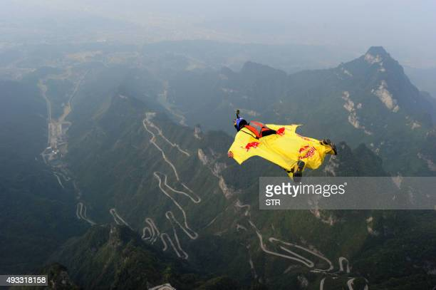 This picture taken on October 18 2015 shows a participant jumping off a platform for a wingsuit flight from Tianmen Mountain in Zhangjiajie central...