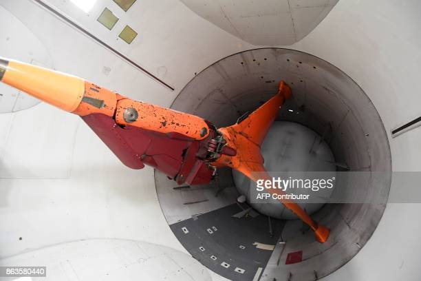 This picture taken on October 18 2017 shows a tripod mount for models inside the blower fan at the ONERA aeronautical tests center that boasts the...