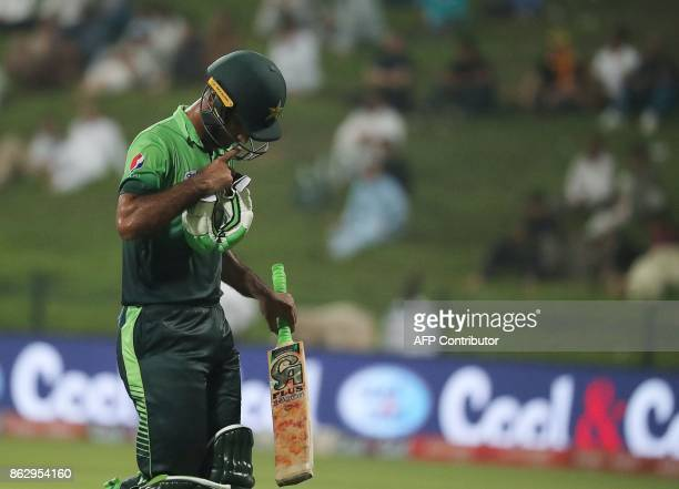 This picture taken on October 18 2017 shows Pakistan's Fakhar Zaman leaving the field during the third one day international match between Pakistan...