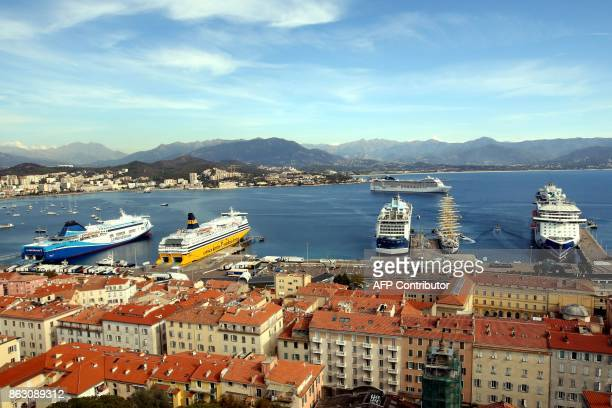 This picture taken on October 19 shows the port of Ajaccio with three cruise boats a sailing cruise boat and two ferries at the wharf on the French...