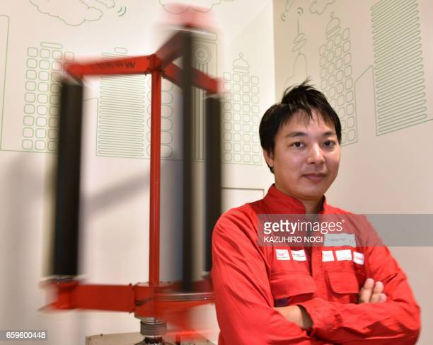 This picture taken on October 20 2016 shows engineer Atsushi Shimizu founder and CEO of the Japanese venture company Challenergy posing next to his...
