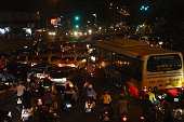This picture taken on October 21 2014 shows heavy traffic with many motorcyclists during rush hour on a main street in downtown Hanoi Vietnam's...
