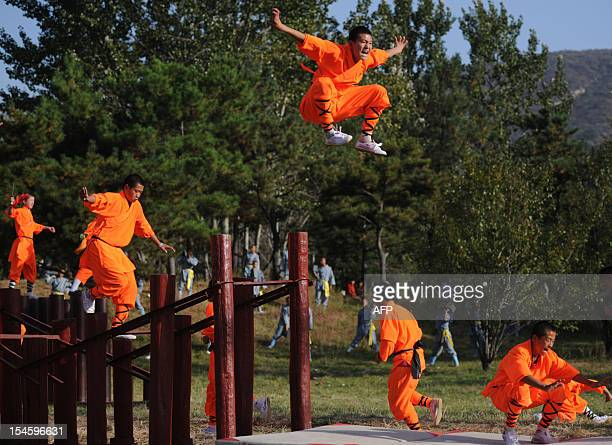 This picture taken on October 22 2012 shows kungfu students performing at a Shaolin Temple to welcome guests during the 9th Zhengzhou International...