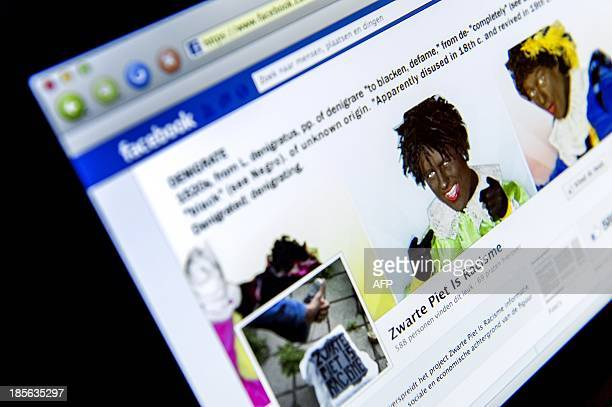 This picture taken on October 23 2013 shows a computer screen displaying the Facebook page of pro Black Pete 'Pietitie' seen in Rijswijk The...
