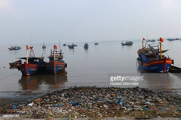 This picture taken on October 25 2015 shows fishing boats anchored near a beach at Hau Loc district central coastal province of Thanh Hoa AFP PHOTO /...