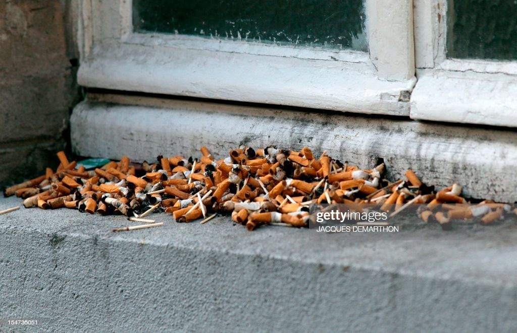 This picture taken on October 25, 2012, shows cigarette butts on a window edge used as an ashtray in Paris. AFP PHOTO/JACQUES DEMARTHON