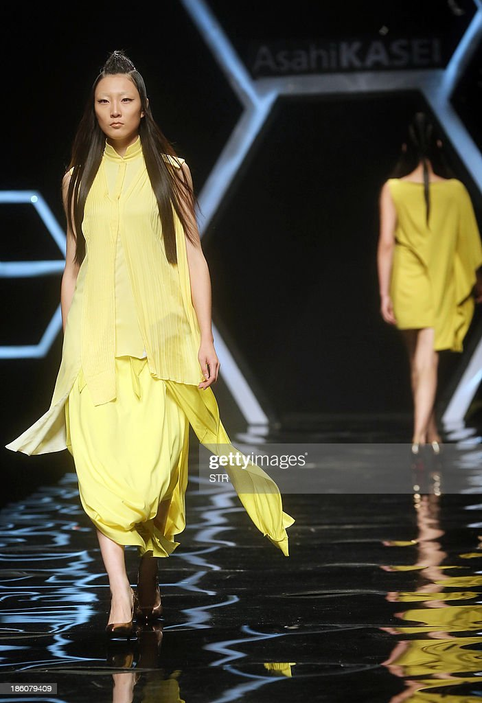 This picture taken on October 27, 2013 shows a model parading a creation from the Asahi Kasei Collection during China Fashion Week in Beijing. China Fashion Week runs from October 25 to November 1. CHINA