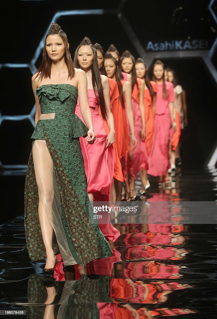 This picture taken on October 27, 2013 shows models parading creations from the Asahi Kasei Collection during China Fashion Week in Beijing. China Fashion Week runs from October 25 to November 1. CHINA