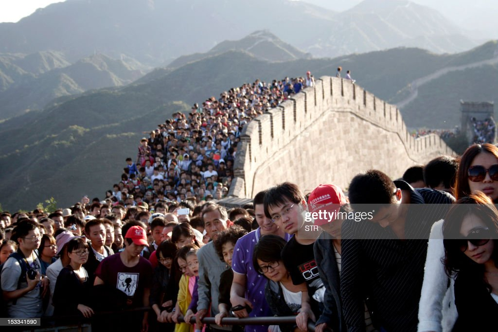 This picture taken on October 3, 2012 shows visitors gathered on the Great Wall of China outside Beijing. Hundreds of millions of tourists crowded into scenery spots, resorts and other tourism destinations scattered across the country while millions of visitors arrived in the capital city over the National Day 'Golden Week' holidays. CHINA OUT AFP PHOTO