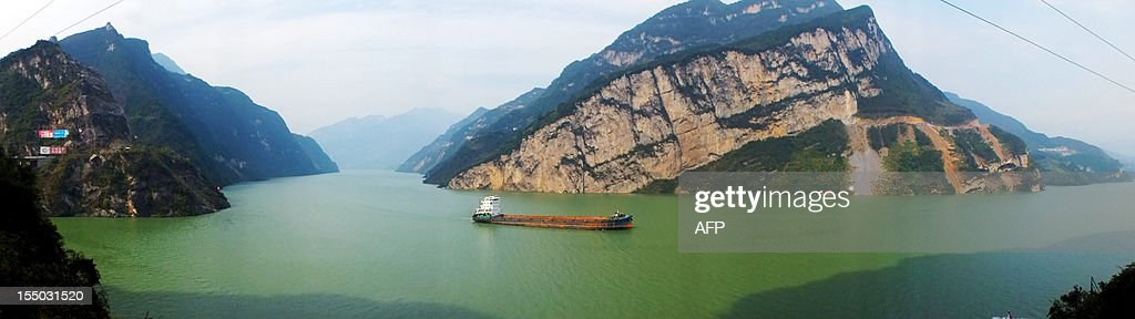 This picture taken on October 30, 2012 shows a boat on the Three Gorges reservoir area in Yichang, central China's Hubei province. The giant and controversial Three Gorges Dam on China's Yangtze River started from July 4 working at full capacity as the last of its 32 generators went into operation, state news agency Xinhua said. CHINA OUT AFP PHOTO