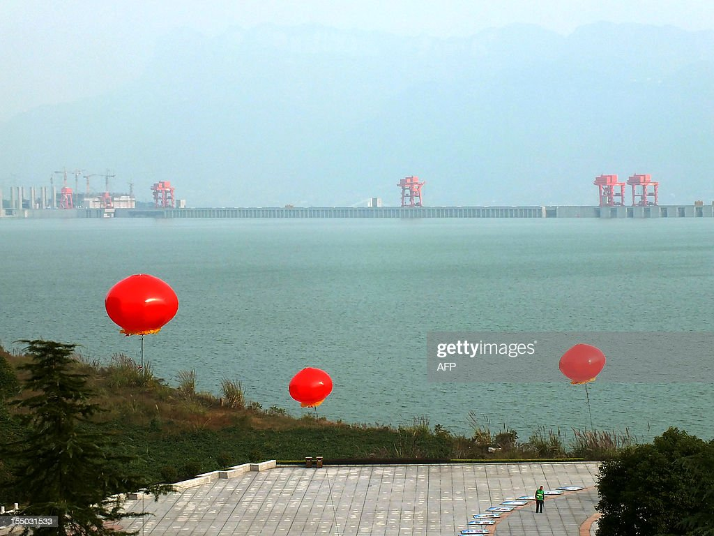 This picture taken on October 30, 2012 shows a guard walking near the Three Gorges Dam on the Yangzte River in Yichang, central China's Hubei province. The giant and controversial Three Gorges Dam on China's Yangtze River started from July 4 working at full capacity as the last of its 32 generators went into operation, state news agency Xinhua said. CHINA