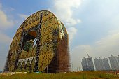 This picture taken on October 30 2013 shows the Circle building under construction in Guangzhou southern China's Guangdong province China's President...