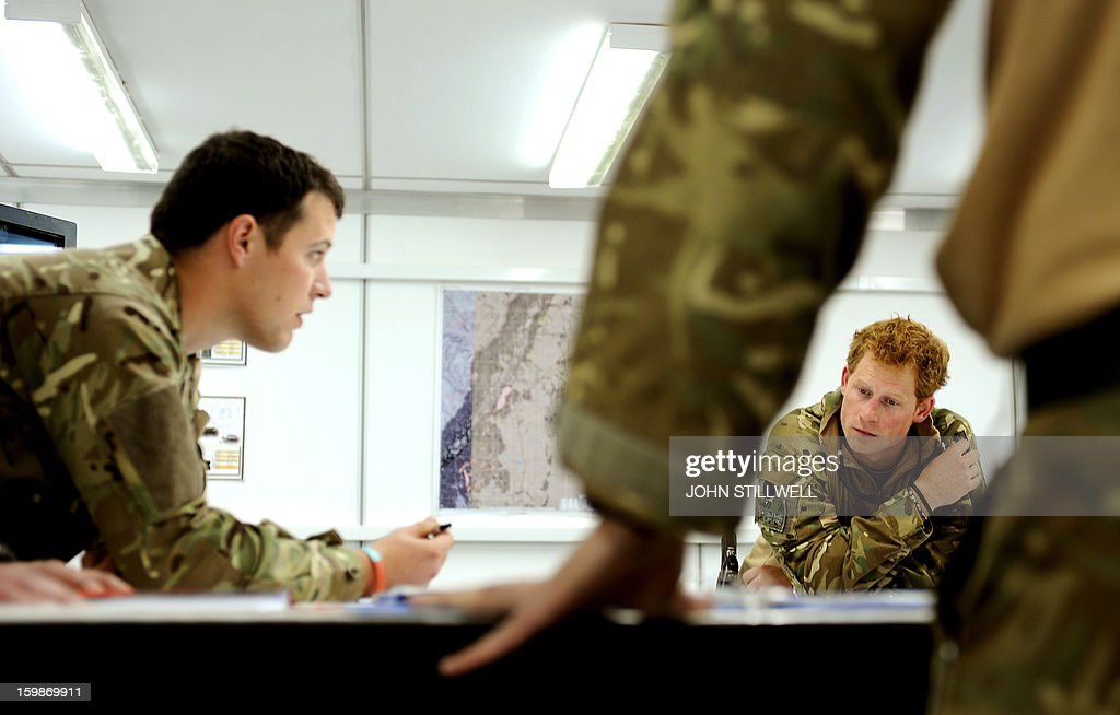 This picture taken on October 31 2012 shows Britain's Prince Harry at a mission briefing at the British controlled flightline at Camp Bastion in...