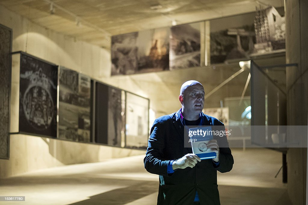 This picture taken on October 6, 2012, shows Dragan Zivadinov, co-founder of the new Cultural Centre of European Space Technologies (KSEVT), holding a booklet inside the KSVET in Vitanje, Slovenia.