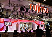 This picture taken on October 7 2014 shows a booth of Japanese computer giant Fujitsu at the Ceatec electronics show in Chiba suburban Tokyo Fujitsu...