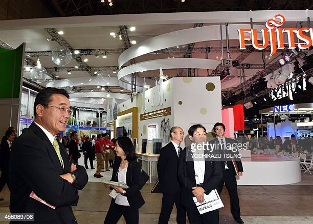 This picture taken on October 7 2014 shows Masami Yamamoto Japanese computer giant Fujitsu at the Ceatec electronics show in Chiba suburban Tokyo...