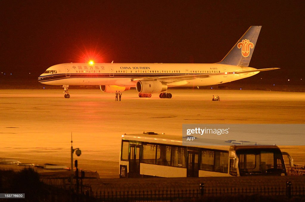 This picture taken on October 8, 2012 shows a China Southern Airlines plane that received a 'fake terrorist threat' landing at an airport in Lanzhou, northwest China's Gansu province. Chinese police arrested a man in the restive northwestern region of Xinjiang for allegedly making a hoax threat that forced a plane into an emergency landing, state media said. CHINA