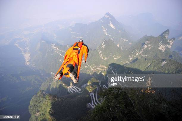 This picture taken on October 8 2013 shows Hungarian wingsuit flyer Victor Kovats jumping into a valley in Tianmen Mountain National Forest Park in...