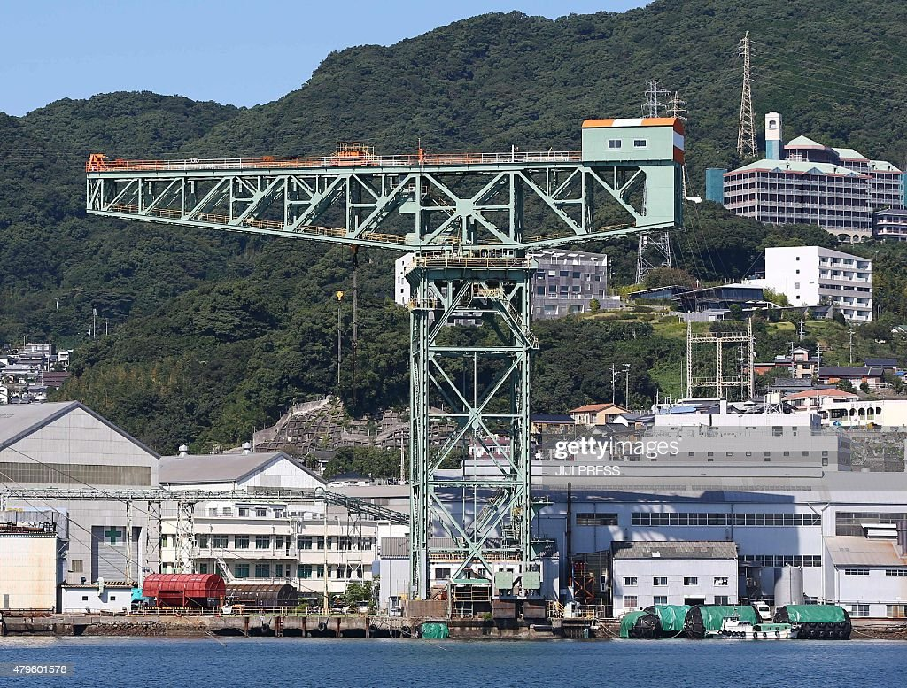 This picture taken on October 8 2014 shows Mitsubishi Heavy Industries' Nagasaki shipbuilding yard in Nagasaki Japan's southern island of Kyushu The...