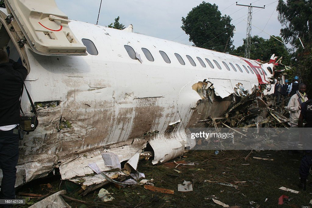 This picture taken on on March 5, 2013 shows the debris of a plane after it crashed into a residential area of Goma in eastern Democratic Republic of Congo killing six people. 'The toll is six dead,' Transport Minister Justin Kalumba said, adding that three passengers had survived.