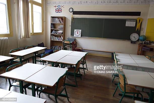 This picture taken on September 1 2014 shows an empty classroom in a primary school of the ninth arrondissement of Paris on the eve of the first day...