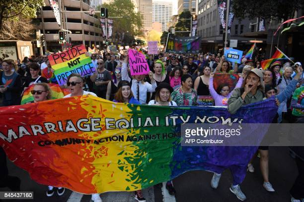 This picture taken on September 10 2017 shows demonstrators taking part in a samesex marriage rally in Sydney As Australia prepares for a contentious...