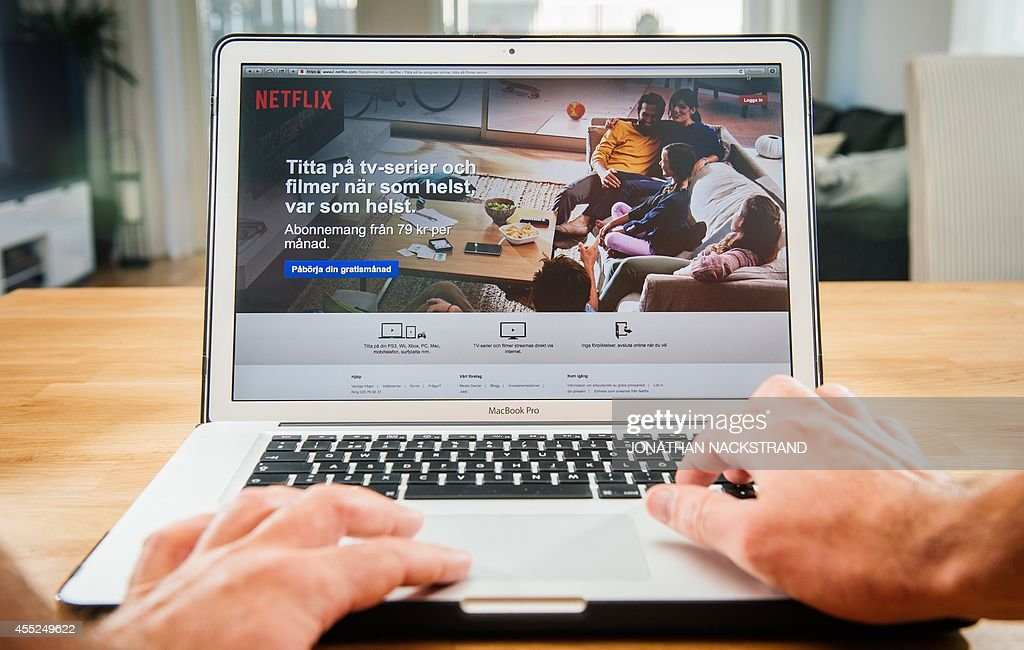 This picture taken on September 11 2014 shows the ondemand internet streaming media provider Netflix on a laptop screen in Stockholm The online...