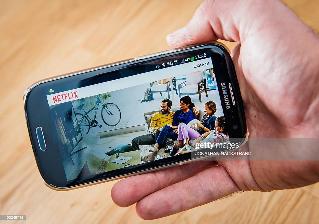 This picture taken on September 11 2014 shows the ondemand internet streaming media provider Netflix on a smartphone in Stockholm The online...