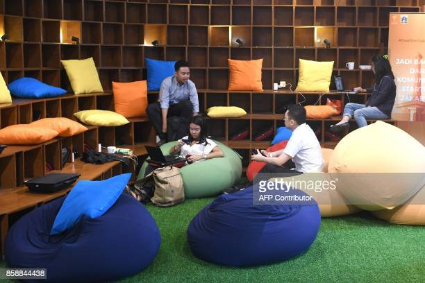 This picture taken on September 12 2017 shows entrepreneurs working at the EVHive event space a coworking space in Jakarta Bigname investors...
