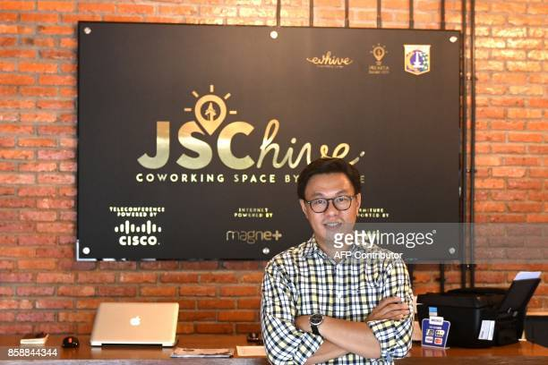 This picture taken on September 12 2017 shows Willson Cuaca one of the coowners of the EVHive event space a coworking space in Jakarta Bigname...
