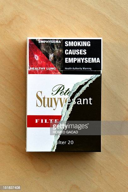 This picture taken on September 12 shows the new packaging design of Peter Stuyvesant cigarettes in Sydney Australia slammed as a 'sick joke' on...