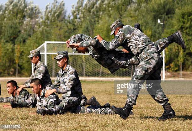 This picture taken on September 16 2015 shows Chinese People's Liberation Army soldiers training at their barracks in Heihe northeast China's...