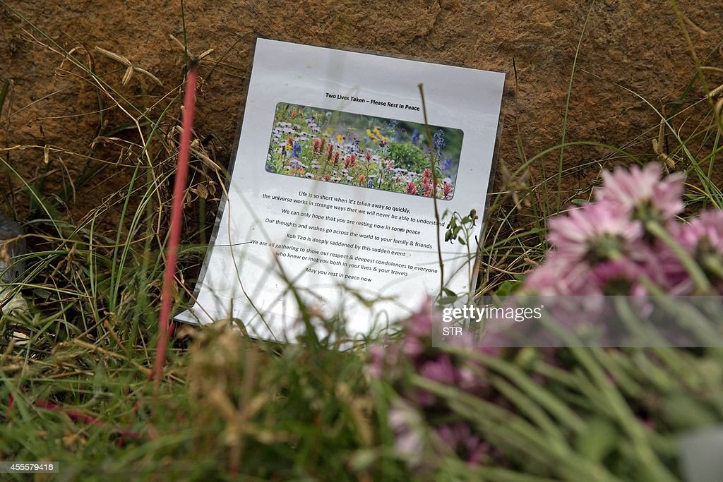 This picture taken on September 17 2014 shows a tribute and flowers placed near the spot where two British backpackers were murdered earlier this...